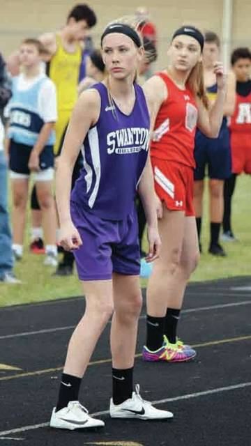 Megan Haselman waiting for the baton handoff in the 4x100 relay Friday at the Lakota Invitational. The Swanton Junior High girls won that race with a time of 56.90.