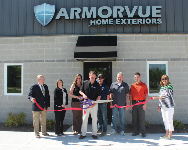 At the ribbon cutting were, from left, Neil Toeppe, Swanton Chamber of Commerce president; Jennifer Hyatt, office manager; Jill Young, office manager; Andrew Toth, general manager; Jamie Sayre, installation manager; Mark McCormick, service manager; Keith Lamont, Soft-Lite Window representative; and Ann Roth, Swanton mayor and chamber member.