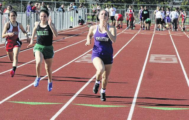 Swanton's Bridget Harlett took first in the 100 meter dash last Tuesday in a NWOAL tri-meet at Wauseon. The Bulldogs were second in both the boys and girls meets.