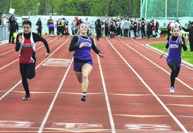 Bridget Harlett of Swanton, center, and Brooke Oberle of Swanton, right, run in the girls 100 meter dash Friday at the NWOAL Track and Field Championships. Harlett won the event ahead of Paige Allison Smith of Wauseon.