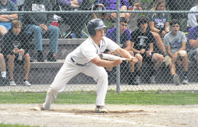 Zach Zawodni of Swanton prepares to drop a bunt in a Division III sectional semifinal against Rossford Wednesday.