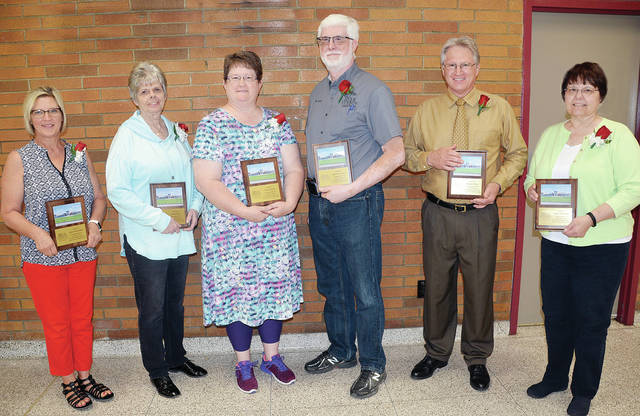Some of the Four County Career Center retirees honored for their service were, from left, Karen Bostelman, custodian, 29 years; Susan Sweet, English instructor, 20 years; Teresa Borton, Math instructor, 29-1/2 years; Kenneth Cronin, Career Based Intervention Coordinator, 10 years; Doug Posey, Automotive Technologies instructor, 33 years; and Kathy Mansfield, In-School Studies Monitor, 12 years. Absent from the photo are Paula Caldwell, accounting specialist, 32-1/2 years; and Scott Lewis, maintenance, 33 years.