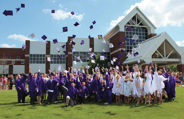 The Swanton High School Class of 2018 celebrates graduation by tossing their caps in the air on Sunday.