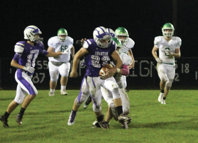 Swanton's Michael Lawniczak carries the ball in a game last season. High school football practices begin across the state of Ohio Monday, July 30.