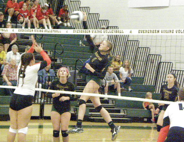 Evergreen's Nicole Brand goes for a kill Thursday at home versus Cardinal Stritch. The Vikings earned wins over Maumee and Cardinal Stritch last week to begin the season.