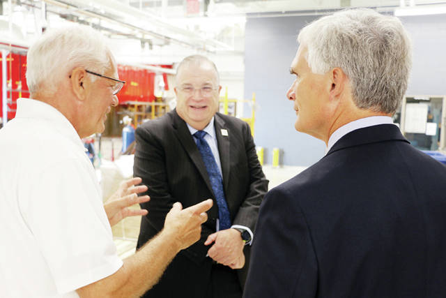 Fifth District Congressman Bob Latta, right, visited Northwest State Community College in Archbold on Aug. 9, and met with President Dr. Michael Thomson, center, Facilities Director Tim Nelson, left, and various department staff to discuss the ongoing importance of student success. Mr. Latta also toured the College's E-wing to see first-hand the renovations to advanced manufacturing facilities. The renovations, which are expected to be completed by early fall.