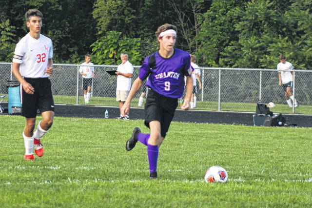 Zach Schaller of Swanton on his way to scoring the team's final goal Thursday versus Liberty Center in NWOAL boys soccer action. He had two of the Bulldogs' three goals.