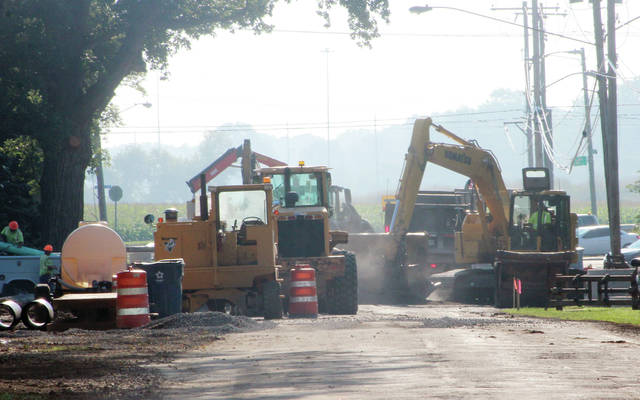 Work continues on the new storm sewer on Church Street on Monday morning.