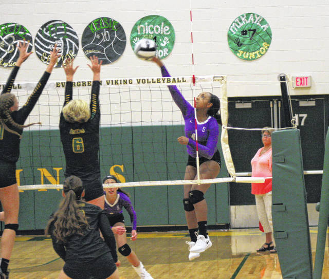 Ashlynn Waddell of Swanton with a kill from the left side last Tuesday at Evergreen. After sweeping Fayette the night before, the Bulldogs fell in four to the Vikings.