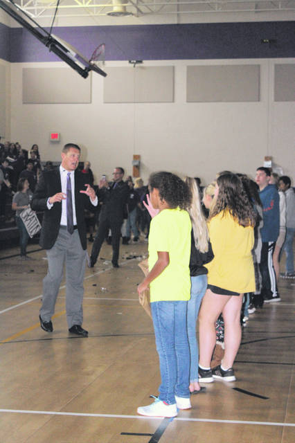 Swanton Middle School principal Matt Smith talks to students before they find out their house.